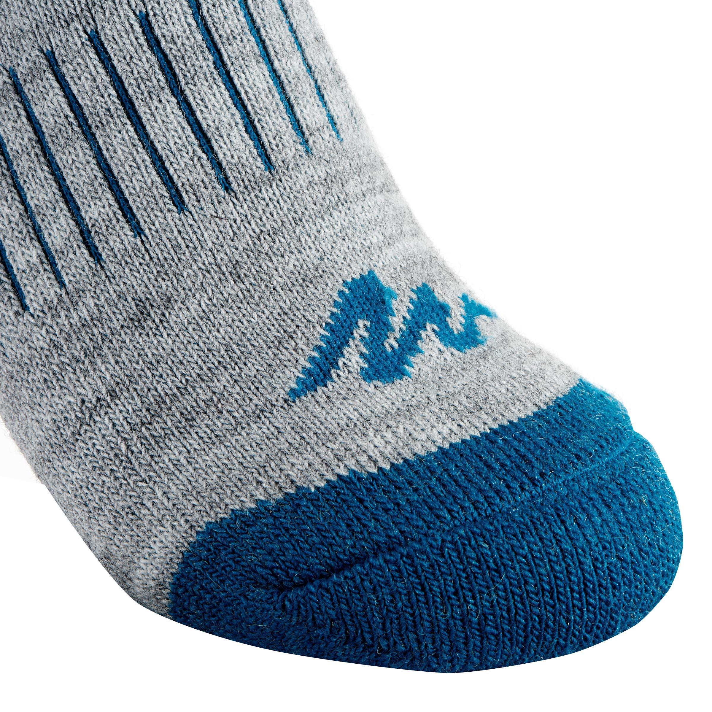 Chaussettes de randonnée neige junior SH100 chaudes mi-hauteur gris bleues.
