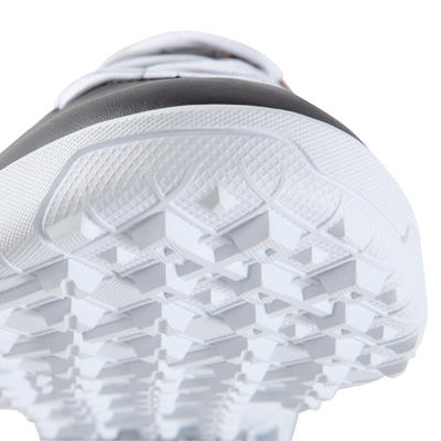 Chaussure de football adulte terrains durs First 100 HG noire rouge blanc