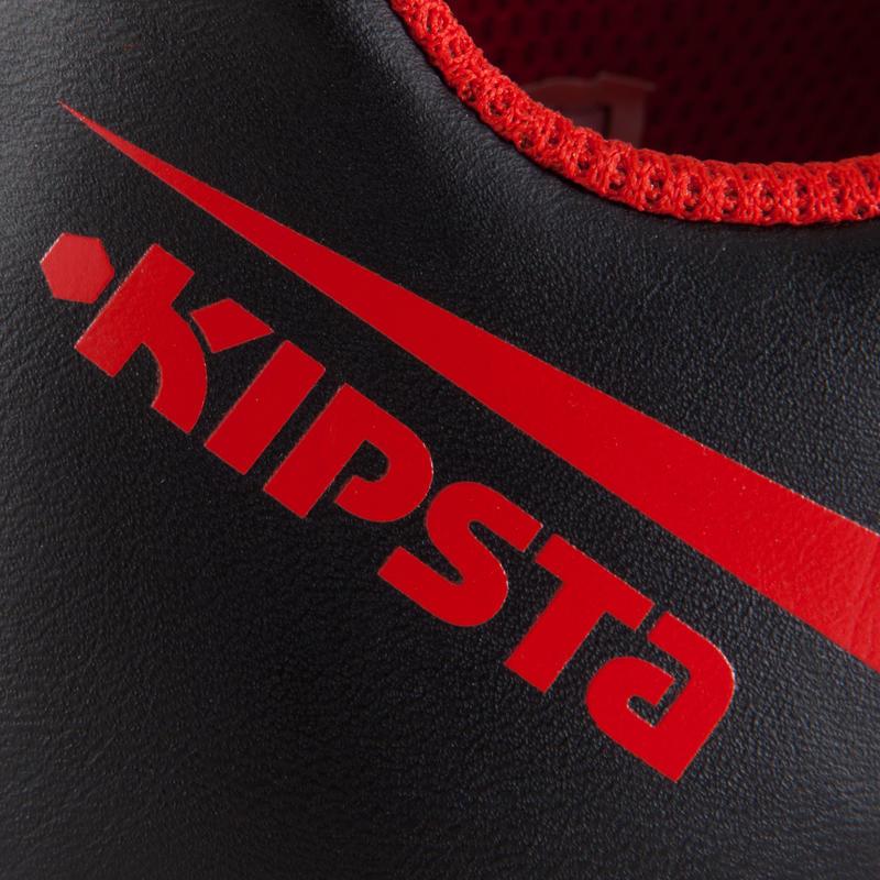 Chaussure de football enfant terrains secs First FG noir blanche rouge