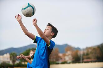 The benefits for kids of playing football with a lighter ball