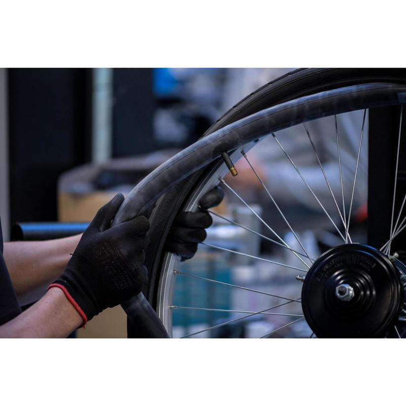 Changement d'un pneu et/ou d'une chambre à air sur roue frein à tambour ou boyau