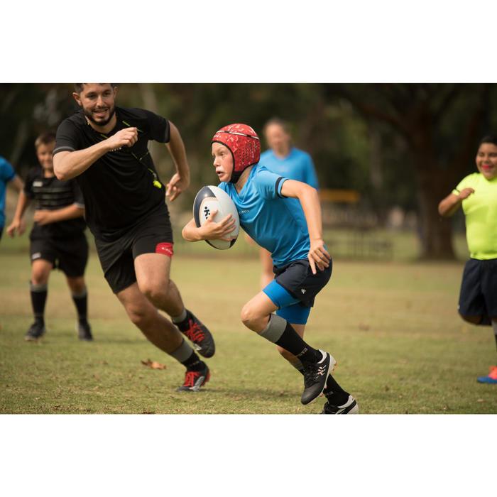 Crampons rugby enfant terrains secs Skill 500 FG noir blanc