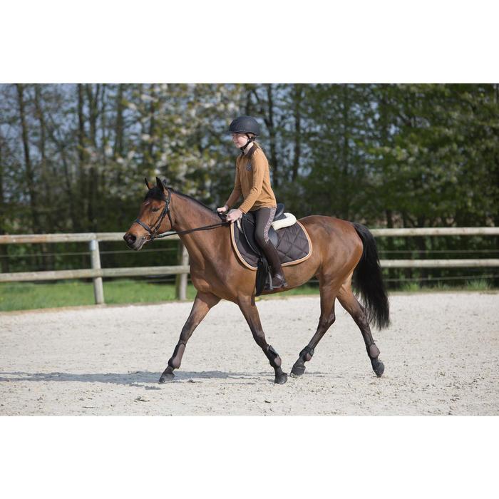 Polo niña equitación manga larga Camel Bolsillo con estampado pluma