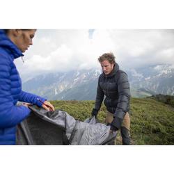 Doudoune trekking montagne TREK500 femme bleu