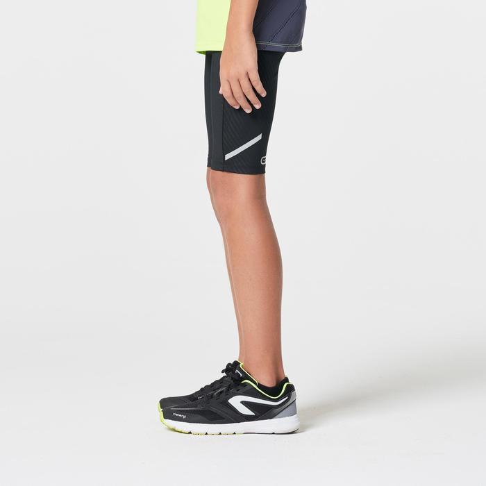 Korte atletiekbroek voor kinderen Kiprun zwart geel fluo