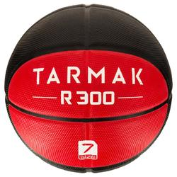 Ballon de basket homme R300 taille 7 noir rouge. Résistant. A partir de 14 ans.