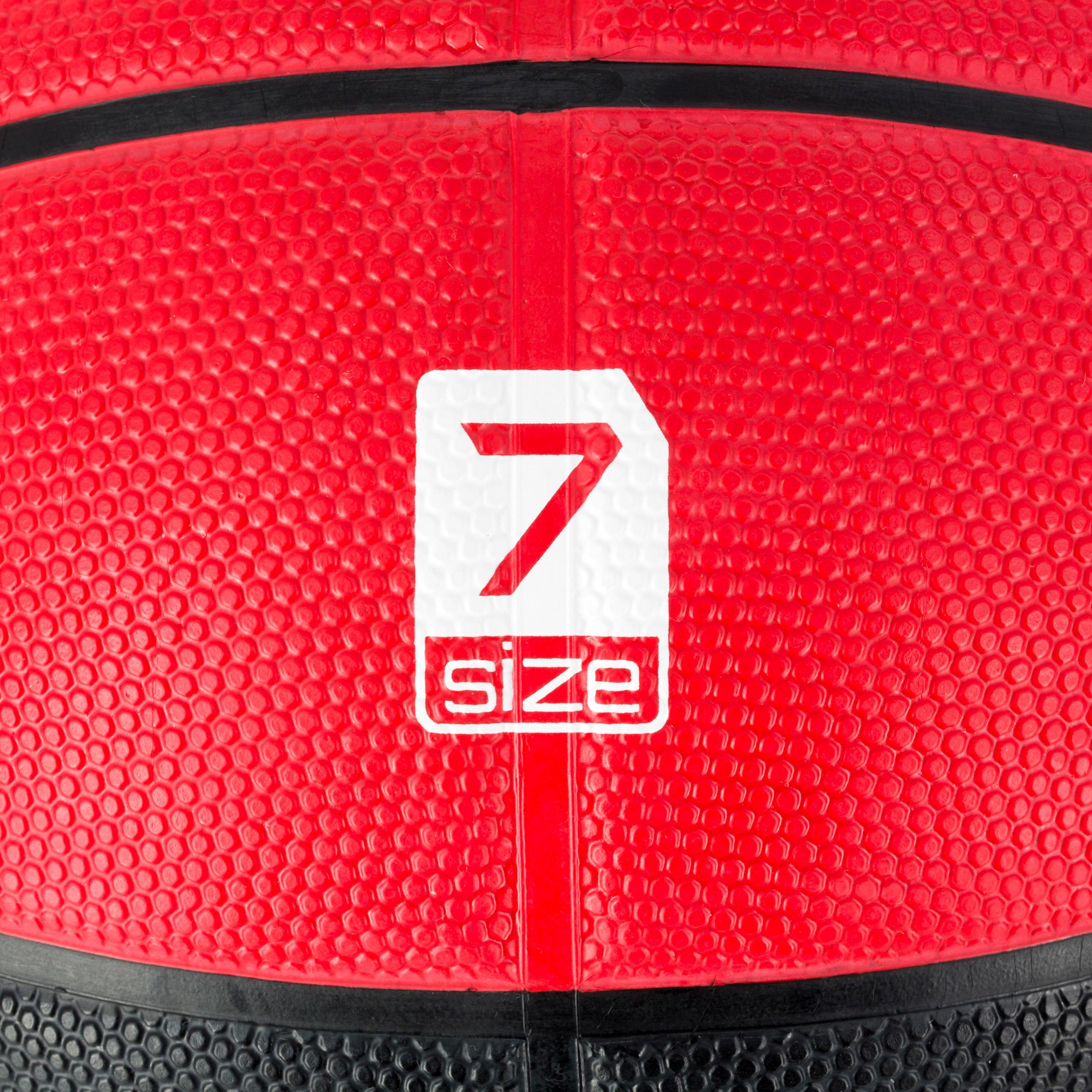Ballon de basket homme R300 taille 7 noir rouge. Résistant. À partir de 12 ans.