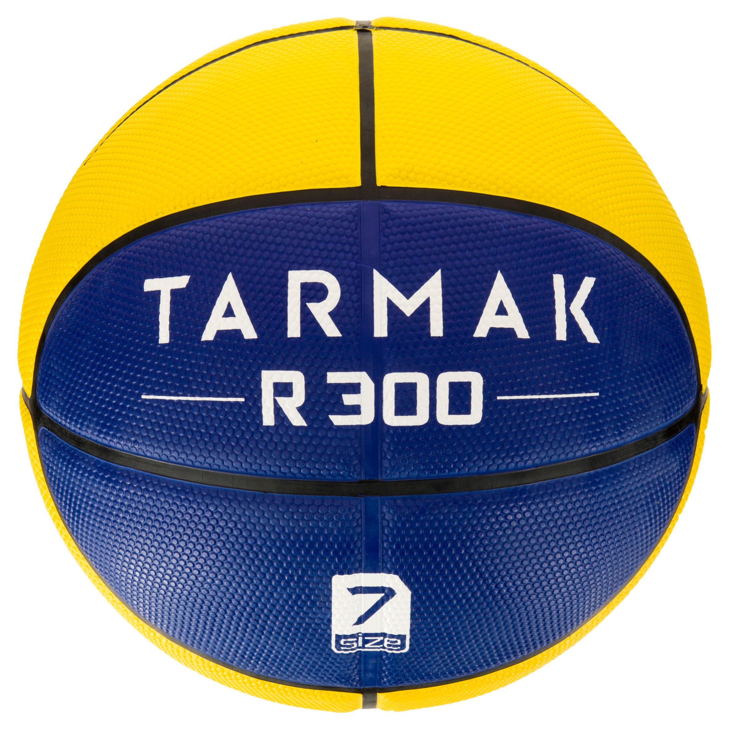 Ballon de basket homme R300 taille 7 jaune bleu. Résistant. À partir de 12 ans.