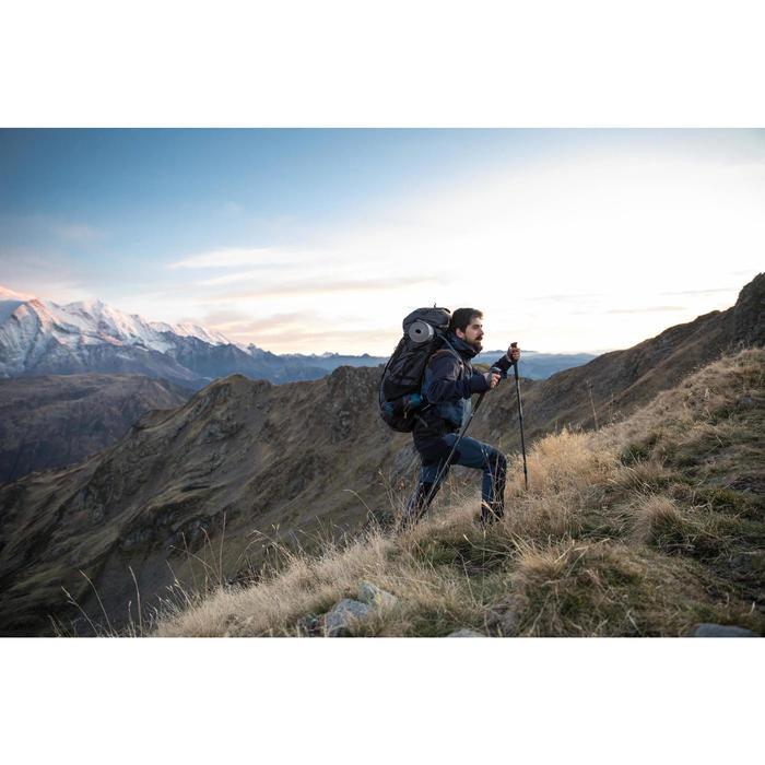 Waterdichte herenjas voor bergtrekking Trek 500 blauw