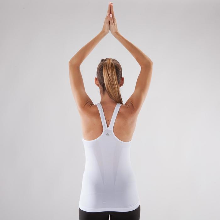 Naadloze damestop dynamische yoga beige / oker