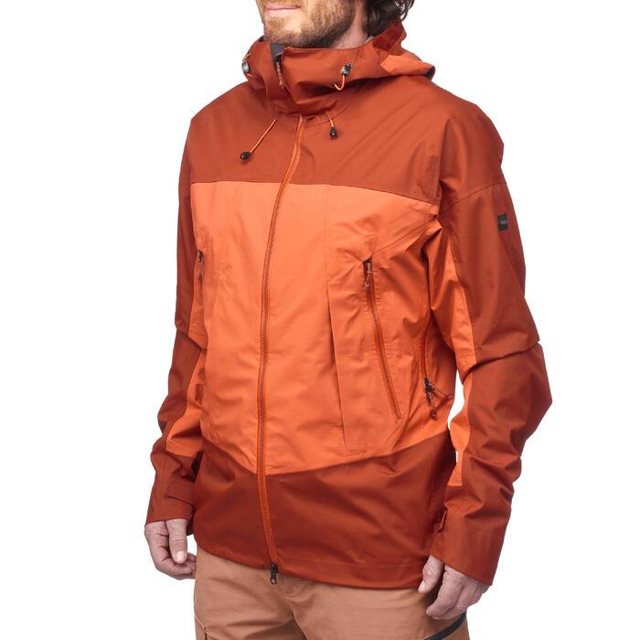 Waterdichte herenjas voor bergtrekking Trek 500 oranje