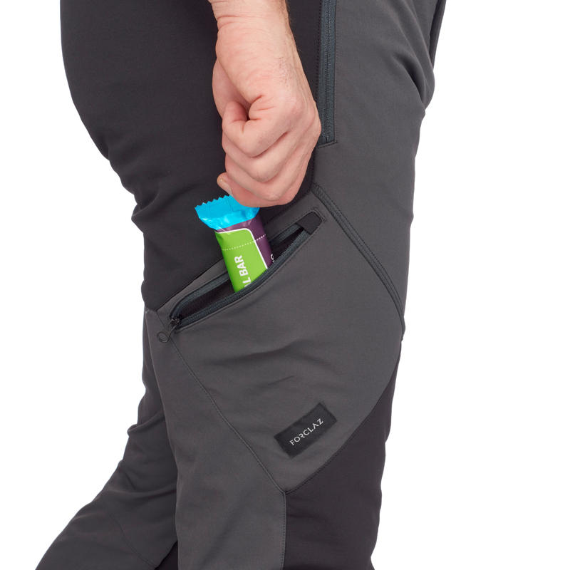 กางเกงขายาวผู้ชายสำหรับการเทรคกิ้งบนภูเขารุ่น TREK 900 (สีเทาเข้ม)