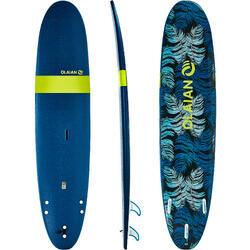 """Planche de surf en mousse 100, 8'6"""". Livrée avec un leash et 3 ailerons."""