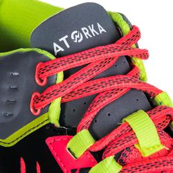 Chaussures de handball mid adulte H500 noir / jaune / rose