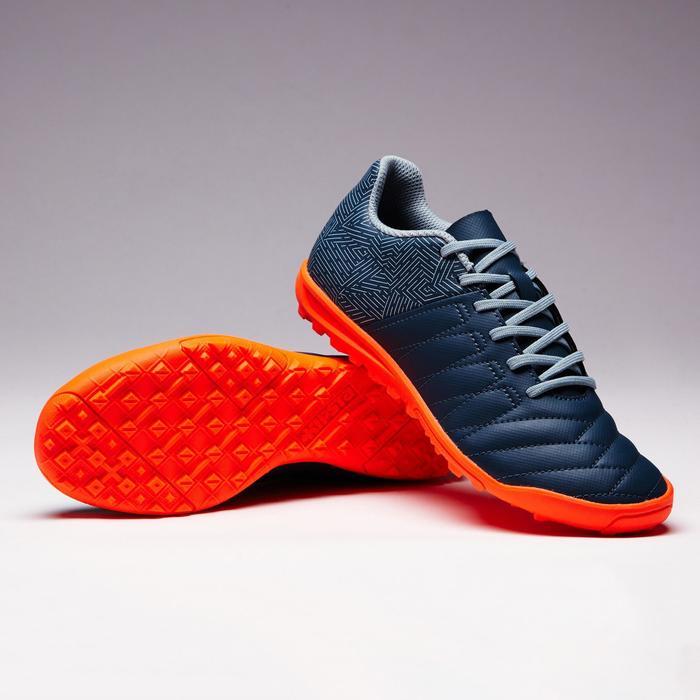 Botas de fútbol júnior terrenos duros Agility 140 HG gris naranja