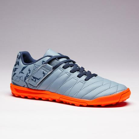 5f9c11b9cb1d94 Chaussure de football à scratch enfant terrain dur Agility 140 HG grise  orange. Previous. Next