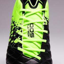 Chaussure de football adulte terrains secs Agility 500 FG noire jaune