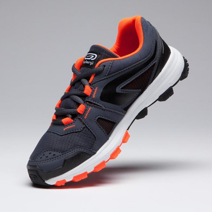Atletiekschoenen voor kinderen Kiprun Grip grijs zwart fluo-oranje