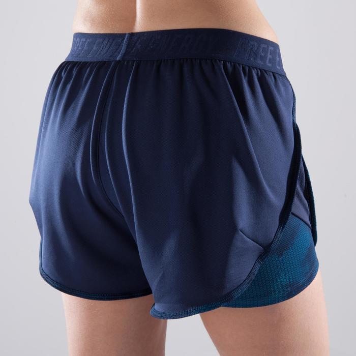 Short 2 en 1 fitness cardio femme bleu marine et imprimés roses 520 Domyos - 1357361