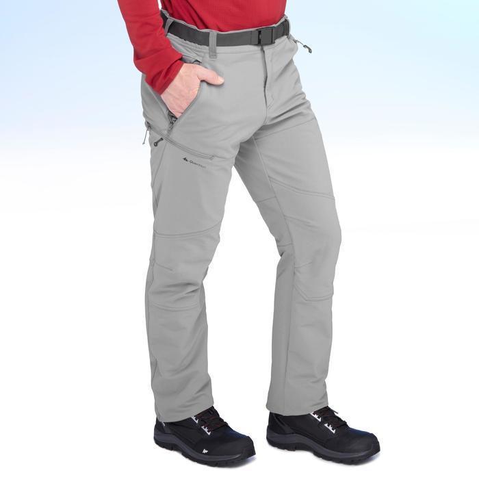 SH500 Men's x-warm stretch black snow hiking trousers. - 1411078