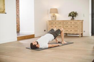 man doing yoga on a mat
