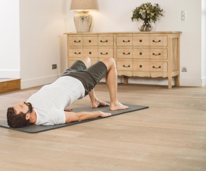 man stretching on a yoga mat