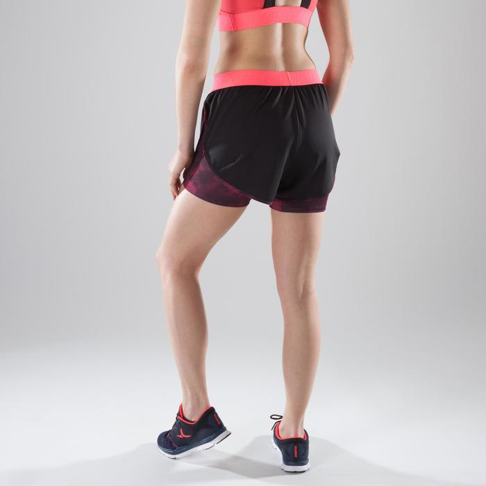 Short 2 en 1 fitness cardio femme bleu marine et imprimés roses 520 Domyos - 1412856