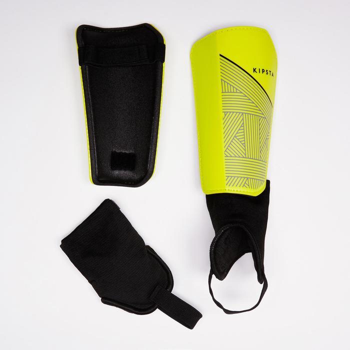 Espinilleras fútbol con tobillera desmontable adulto F140 amarillo negro