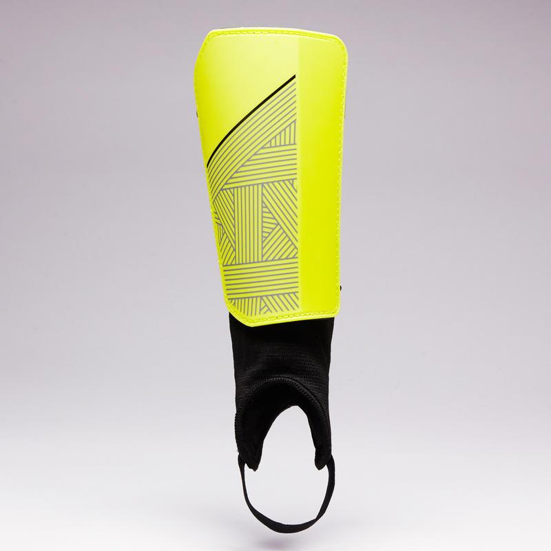 สนับแข้งผู้ใหญ่สำหรับใส่เล่นฟุตบอลรุ่น F140 (สีเหลือง/ดำ)