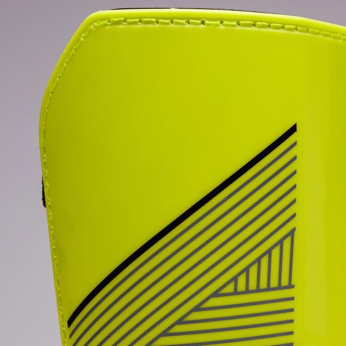 兒童款足球護脛片F140。 黃色/黑色。