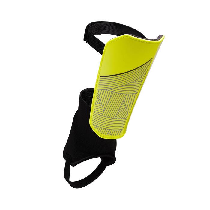 Scheenbeschermers voetbal F140 met afneembare enkelsok geel/zwart