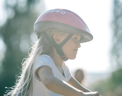 CORRECTLY ADJUSTED CHILD'S BIKE HELMET FOR EFFECTIVE PROTECTION