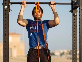 man working out with a resistance band