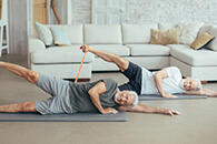 two men doing Pilates at home
