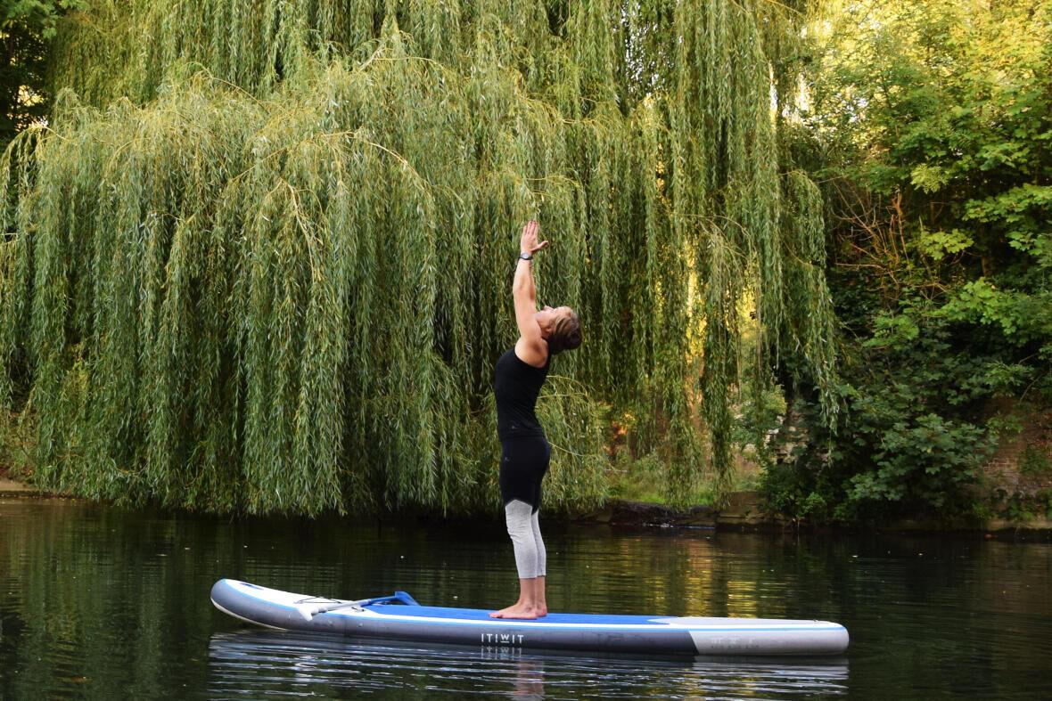 stand up paddle board yoga urdha hastasana