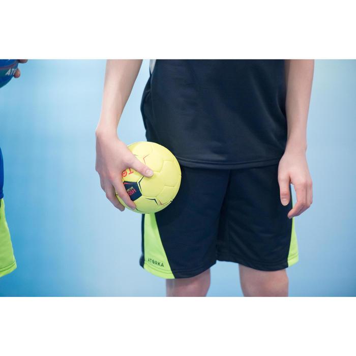 Short de balonmano júnior H100 azul / amarillo