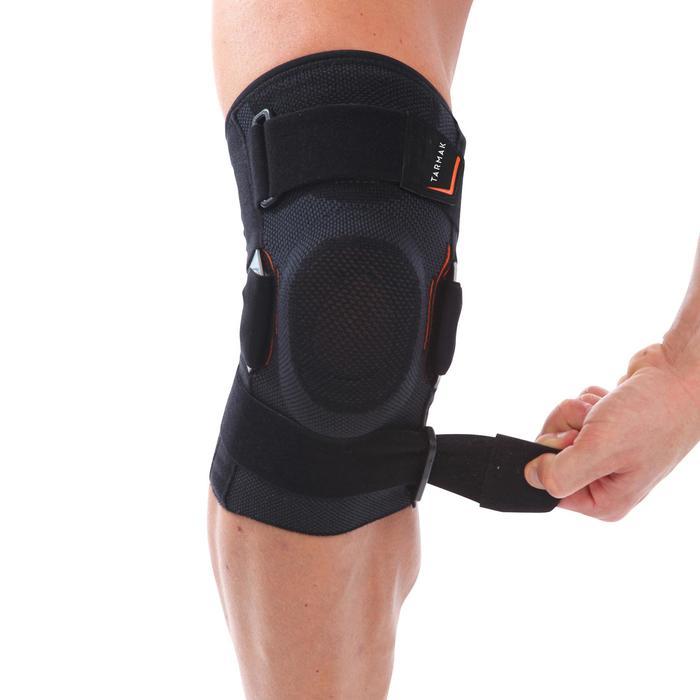 Kniebandage Strong 700 Unterstützung Bänder links/rechts Erwachsene schwarz