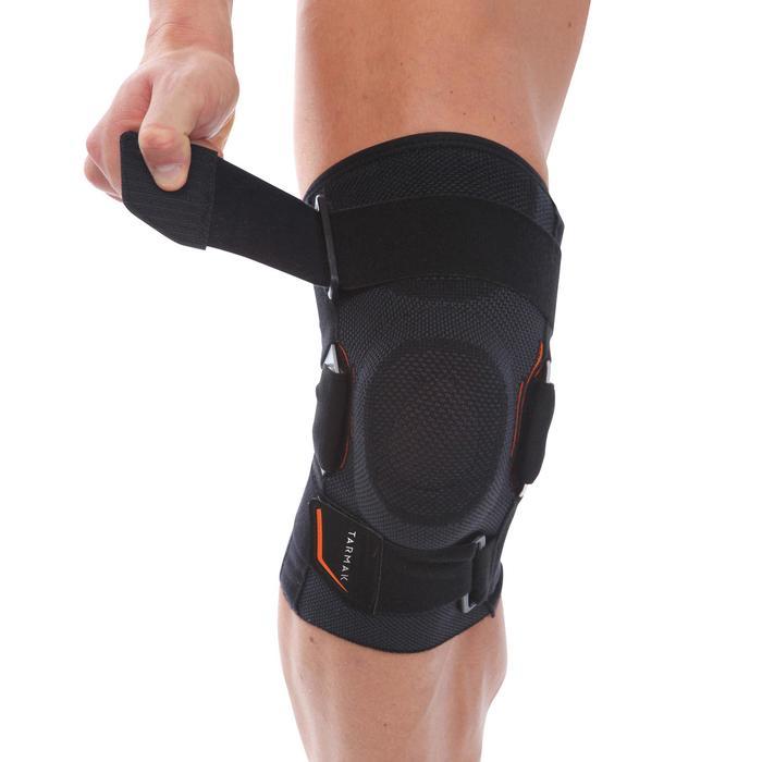 Kniebandage Strong 700 links/rechts Bänderstützung Erwachsene schwarz