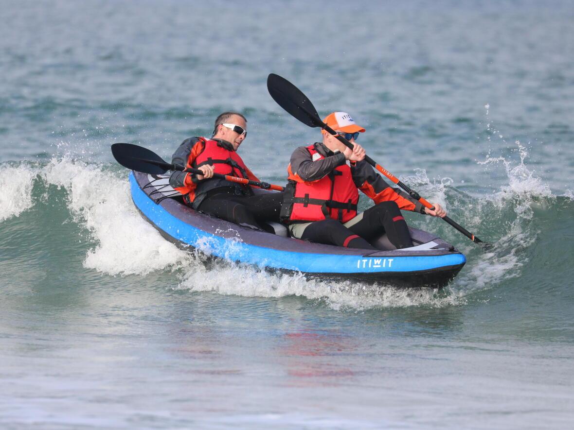 sea kayak surfing
