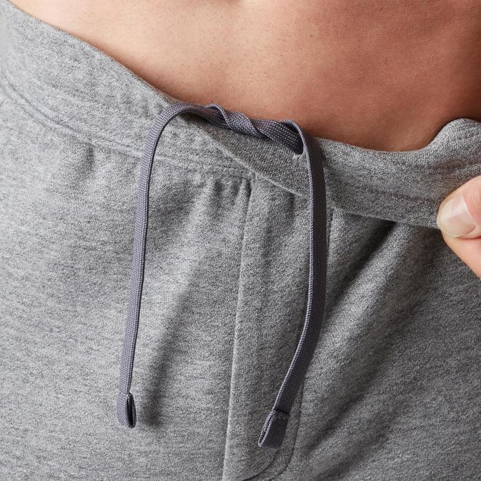 Pantalon 900 slim zip Gym Stretching homme gris clair