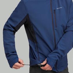 Chaqueta softshell trekking montaña TREK 900 WINDWARM hombre azul
