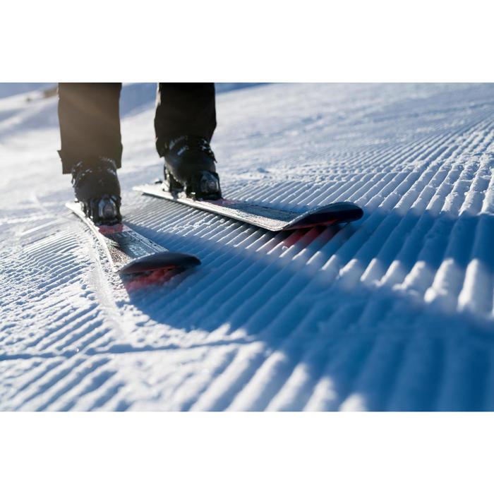 搭配固定器BOOST 900的男款雪道雙板滑雪板黑色與橘色