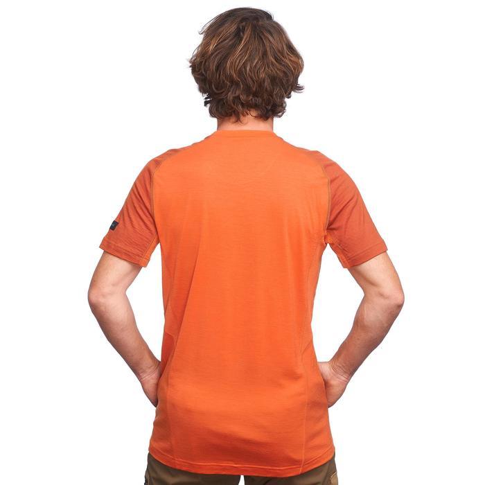 Merino shirt met korte mouwen voor bergtrekking heren Trek 500 oranje