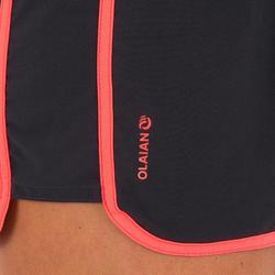 Boardshort femme TINI COLORBLOCK avec ceinture élastiquée et cordon de serrage.