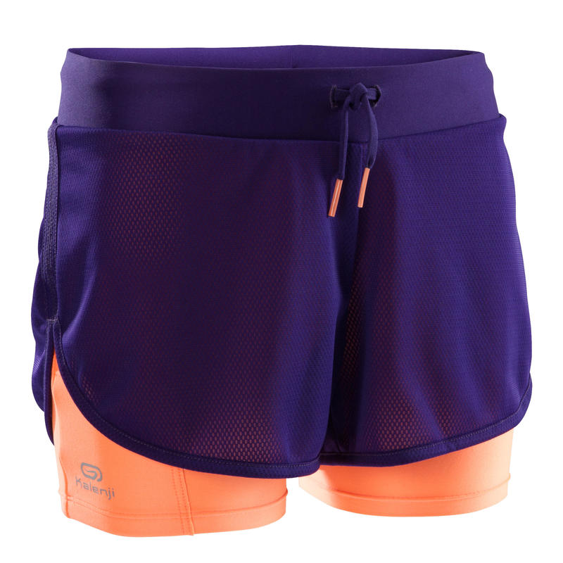 Kiprun girl's athletics shorts purple and neon coral.