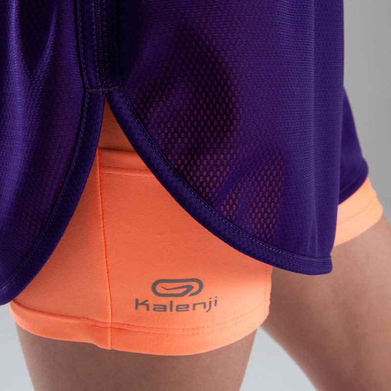 Kiprun girl's athletics shorts purple and neon coral.