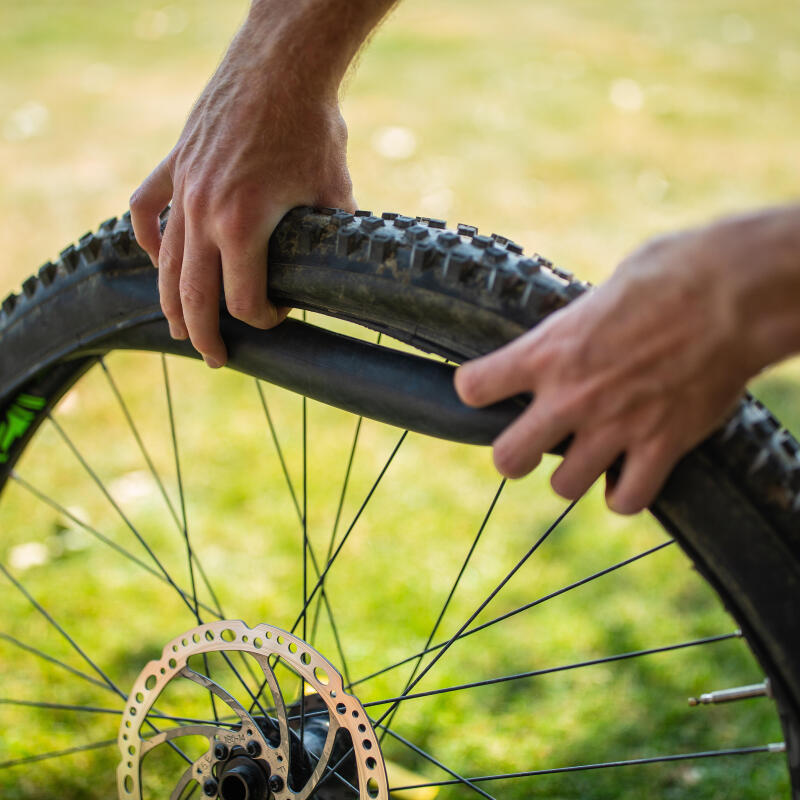 person changing a bike inner tube