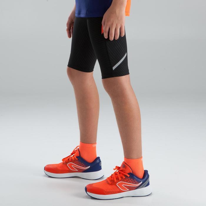 Kiprun children's athletics tight shorts black orange