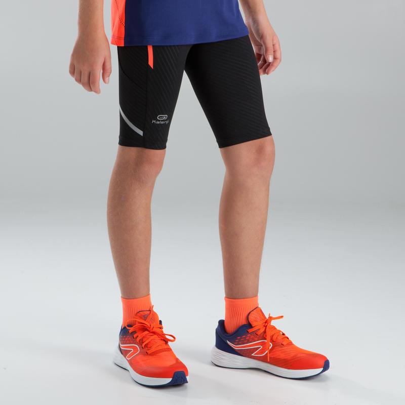 Calza 3/4 de atletismo niño kiprun negro naranja