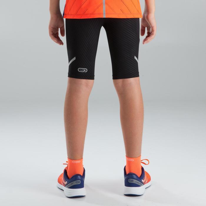 Korte atletiek tight voor kinderen Kiprun zwart oranje